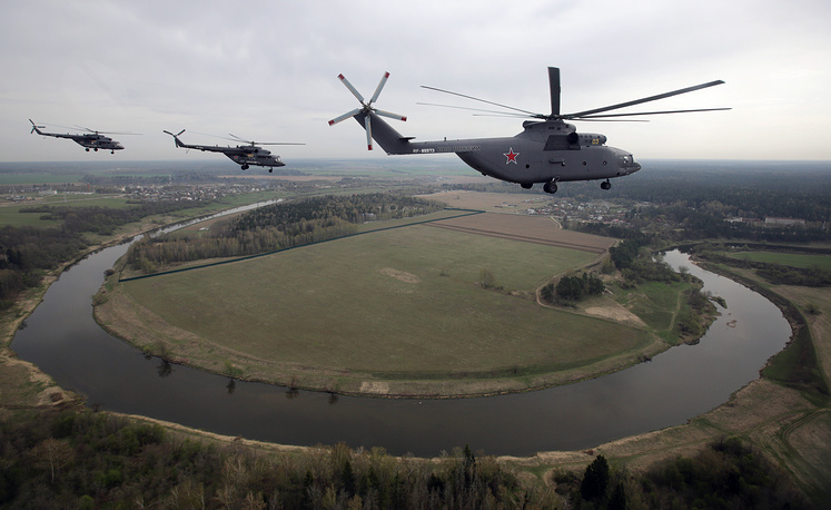 Mi-26 heavy transport helicopter is used for civilian and military operators. Photo: Mi-26 and Mi-8 helicopters