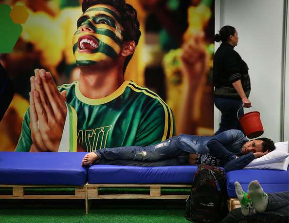 Passengers sleeps in Curitiba's airport during the 2014 World Cup in Brazil