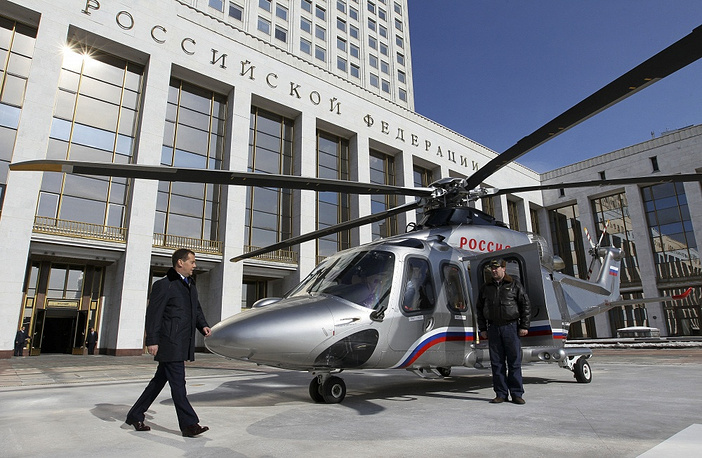 """Chapter 6. The Government of the Russian Federation. """"The decisions and orders of the Government of the Russian Federation shall be obligatory for fulfillment in the Russian Federation"""".  Photo: Russian Prime Minister Dmitry Medvedev at a helicopter pad outside the White House, a government building in Moscow"""