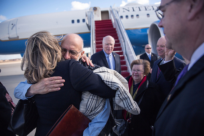 The announcement was accompanied by an exchange of imprisoned spies. Photo: Alan Gross is greeted with hugs after arriving at Joint Base Andrews, December 17, 2014