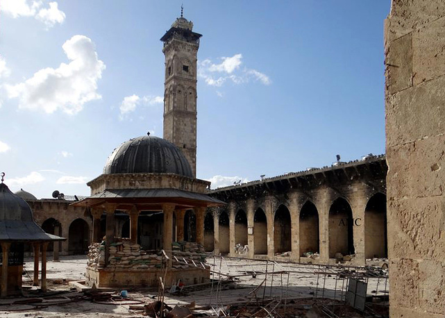 Minaret of a famed 12th century Umayyad mosque before it was destroyed by the shelling, in the northern city of Aleppo, Syria