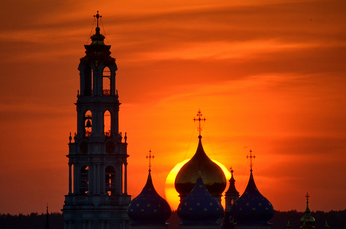 The bell tower of the Holy Trinity and St. Sergius monastery near Moscow at sunset