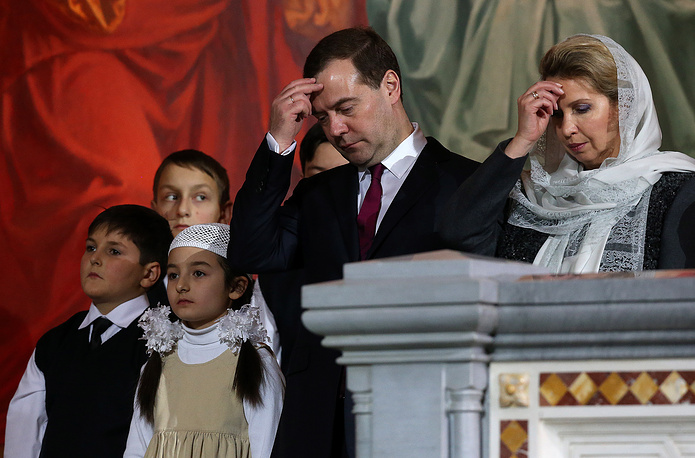 Russian Prime Minister Dmitry Medvedev and his wife attend a Christmas service at Christ the Savior Cathedral in Moscow