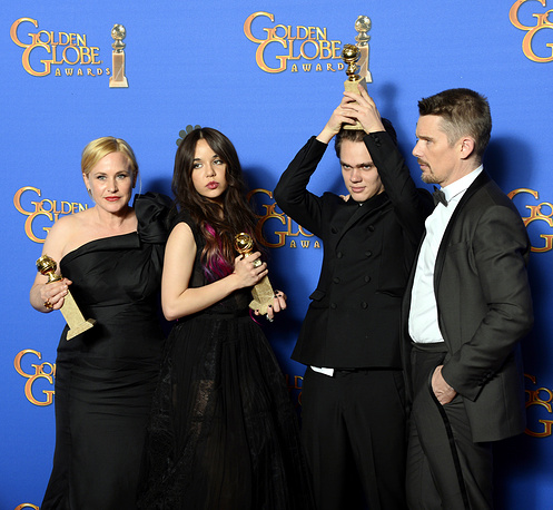 Cast members from 'Boyhood' after winning Best motion picture - drama at the 72nd Annual Golden Globe Awards at the Beverly Hilton Hotel, California, USA
