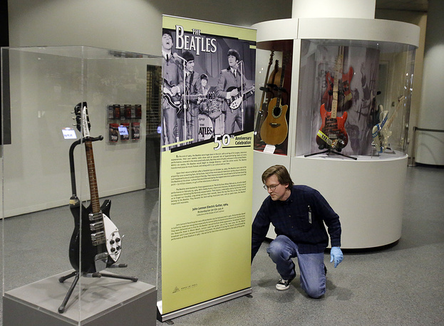 The installation of John Lennon's Rickenbacker electric guitar at the Rock and Roll Hall of Fame and Museum in Cleveland, 2014