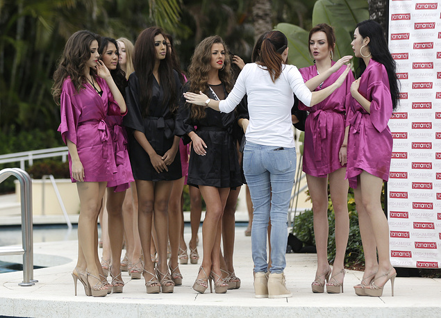 Miss Universe contestants listen to instructions before participating in the swimsuit runway show