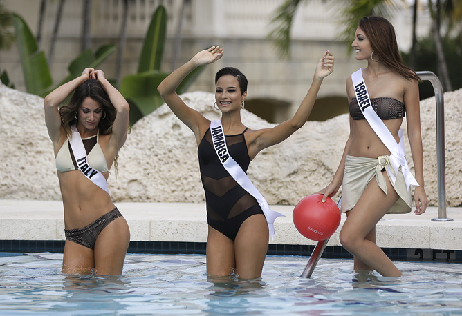 Miss Universe contestants of Italy, Jamaica, Israel during the swimsuit runway show