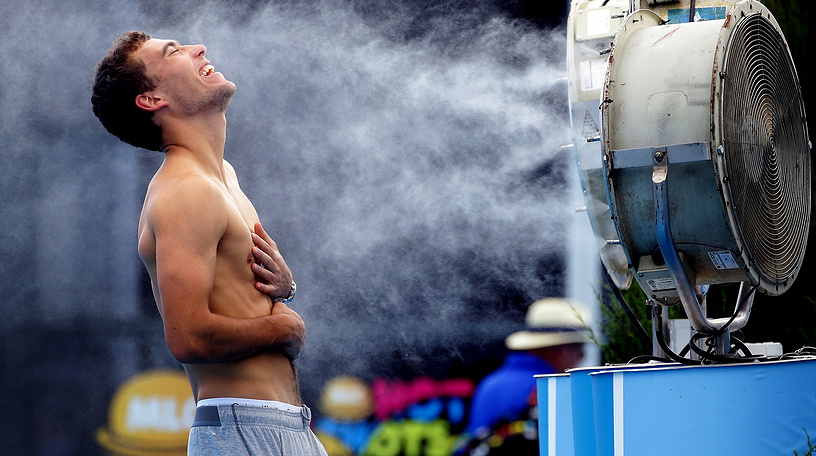 The organizers install special fans to cool the athletes and spectators. Photo: Poland's Jerry Janowicz is sprayed with cool water at the Australian Open tennis championship in Melbourne, 2014