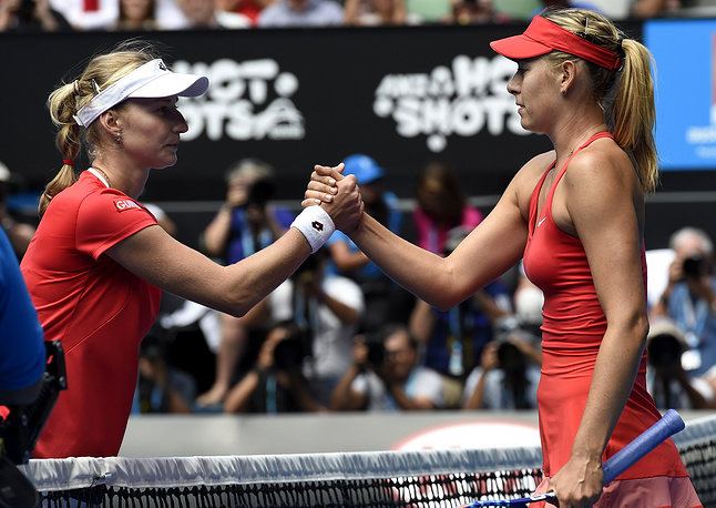 Photo: Maria Sharapova (right) is congratulated by Ekaterina Makarova at the net after winning semifinal match at the Australian Open 2015