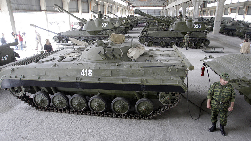 Russian officer standing next to an armored personnel carrier at the military base in Tskhinvali, South Ossetia, 2009