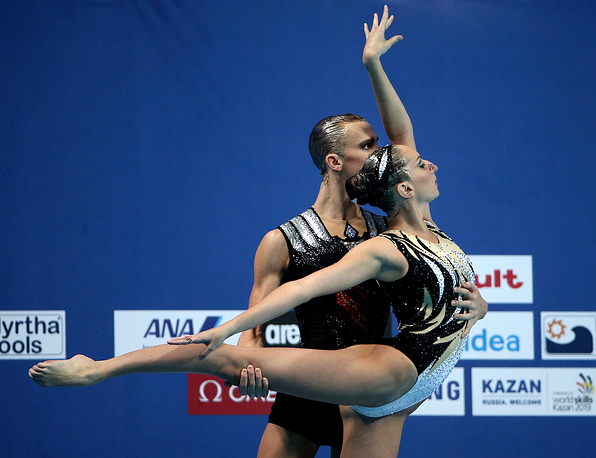 Russia's Darina Valitova and Alexander Maltsev competing to win gold in the synchronised swimming mixed duet free final, July 30