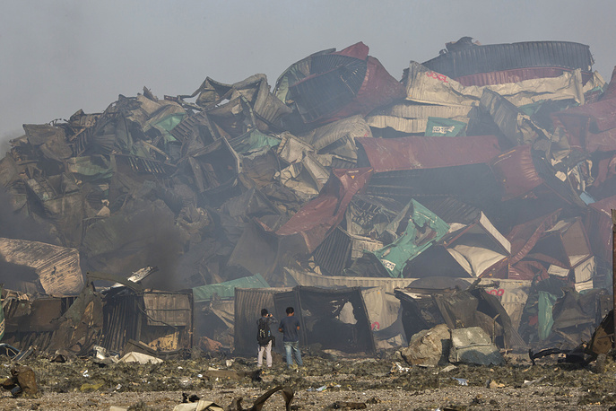 Deformed remains of containers after an explosion at a warehouse in northeastern China's Tianjin