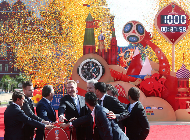 Russian presidential aide Igor Levitin, goalkeeper Igor Akinfeev of the country's national football team, Russia's Sport Minister and Football Union President Vitaly Mutko, Russia's First Deputy Prime Minister Igor Shuvalov and Moscow Mayor Sergei Sobyanin launching the clock counting down 1000 days to go until the 2018 FIFA World Cup