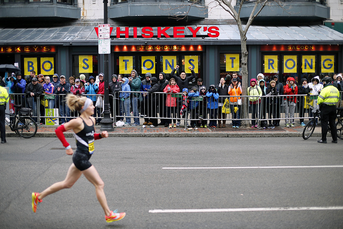 Spectators cheering for runners near the finish line of the Boston Marathon, 2015
