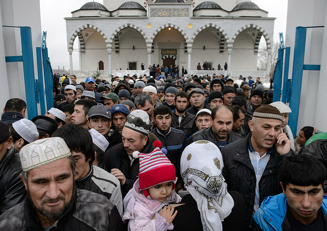 Muslims seen outside the Imam Ismail Al-Bukhari's Copper Mosque during the celebration of Eid al-Adha, in the town of Verkhnyaya Pyshma, Sverdlovsk region