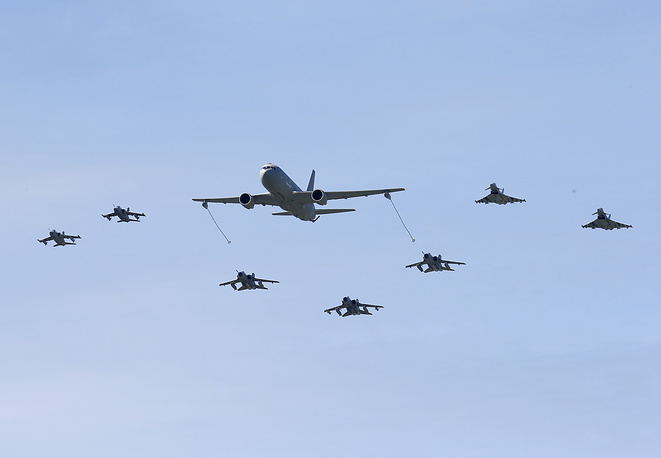 Boeing KC-767 aerial refueling and strategic transport aircraft flying along jet fighters during NATO Trident Juncture exercise 2015