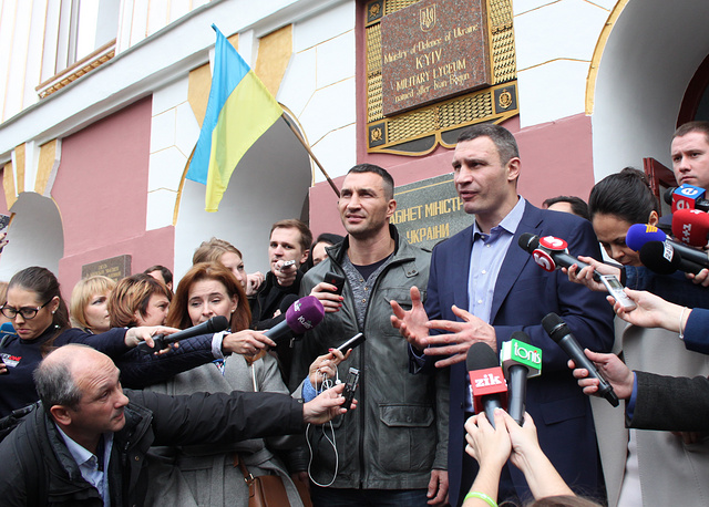 WBA boxing champion Vladimir Klitchko and Kiev Mayor Vitali Klitschko talking to the media outside a polling station after casting their ballots