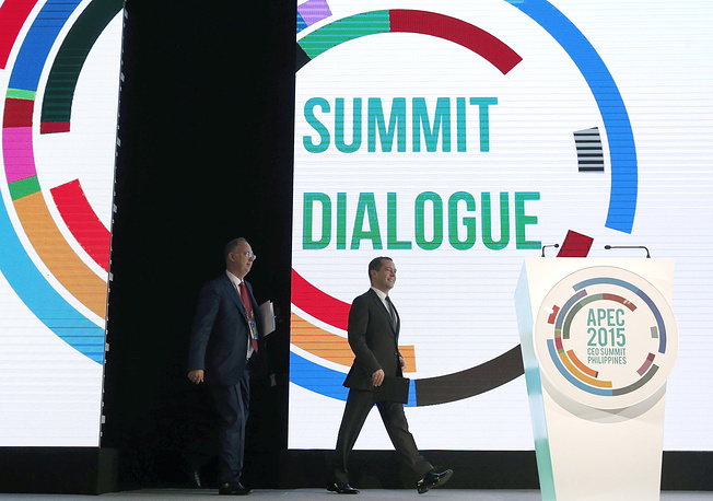 Russia's Prime Minister Dmitry Medvedev and Russian Direct Investment Fund CEO Kirill Dmitriev at a special session of the APEC Business Summit on Russia's approaches to promoting trade and investment cooperation
