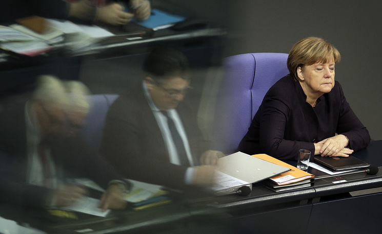 Angela Merkel listening to a meeting of the German Federal Parliament in Berlin, Germany, November 25, 2015