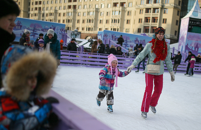 Skating on an ice rink in Moscow's Revolution Square