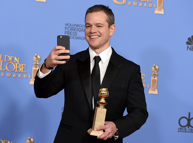 "Matt Damon with the award for best performance by an actor in a motion picture - musical or comedy for ""The Martian"""