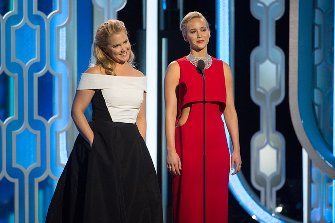 "Jennifer Lawrence (right) onstage at the 73rd Annual Golden Globe Awards as she received the award for best performance by an actress in a motion picture - musical or comedy for ""Joy"""