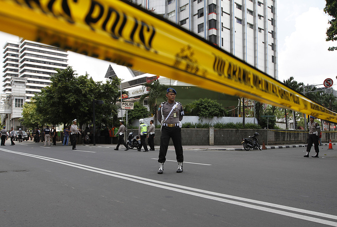 Police cordon sealing off the scene of a bomb blast in Jakarta