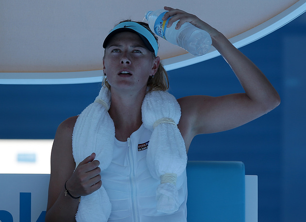 Maria Sharapova of Russia pouring water over her head during a break in her second round match against Karin Knapp of Italy at the Australian Open tennis championship in 2014