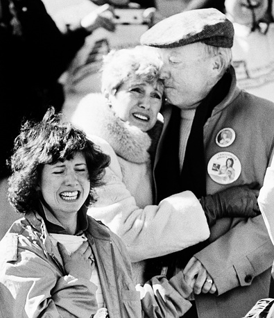 The family of Christa McAuliffe, who was scheduled to become the first teacher in space, realizing the horror after the space shuttle orbiter Challenger blew apart after liftoff. The sister of Christa, Betsy, left, and parents Grace and Ed Corrigan