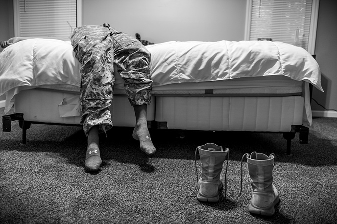 US photographer Mary F. Calvert, 1st prize in the Long Term Projects category. The series taken between 2013 and 2015 portrays women who have been raped or sexually assaulted during their service with the US Armed Forces. The picture shows US Army Spc. Natasha Schuette, 21, who was pressured not to report being assaulted by her drill sergeant during basic training at Fort Jackson, South Carolina. Fayetteville, North Carolina, US, 21 March 2014