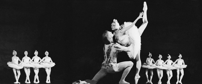 Bolshoi Theater principal dancers Alexander Godunov as Prince and Ludmila Semenyaka as Princess Odette performing a scene from Tchaikovsky's Swan Lake ballet, 1978