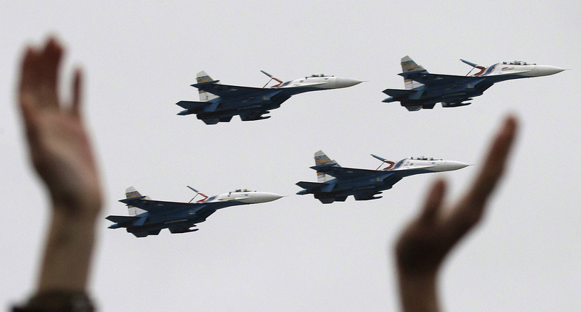People applauding the Sukhoi Su-27 fighter jets of the Russkiye Vityazi (Russian Knights) aerobatic team during MAKS-2009 (the International Aviation and Space Show) in Zhukovsky, outside Moscow, Russia, 2009