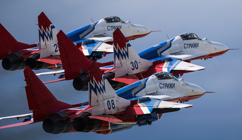 Mikoyan MiG 29 fighter jets of the Strizhi (Swifts) aerobatic team flying over Kubinka after a rehearsal for a 9 May Victory Parade commemorating the 71st anniversary of Soviet victory over Nazi Germany in the 1941-1945 Great Patriotic War