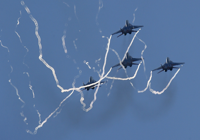MiG 29 of the Strizhi (Swifts) performing during the International Maritime Defense show in St.Petersburg, 2015