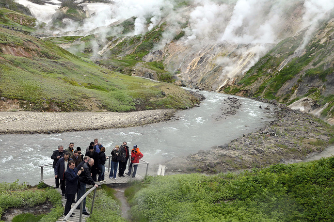 Tourists visiting the Valley of Geysers in the Kronotsky State Biosphere Nature Reserve on Kamchatka peninsula
