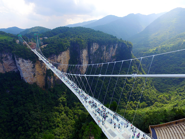 Zhangjiajie Grand Canyon Glass Bridge was opened to the public on August 20th in the Hunan Province, and is now the tallest and longest glass bridge ever built. The 375-meters long bridge, featuring 99 pieces of five-centimeter-thick reinforced glass as its floor, spans some 300 meters above the bottom of the Karst valley in the scenic zone