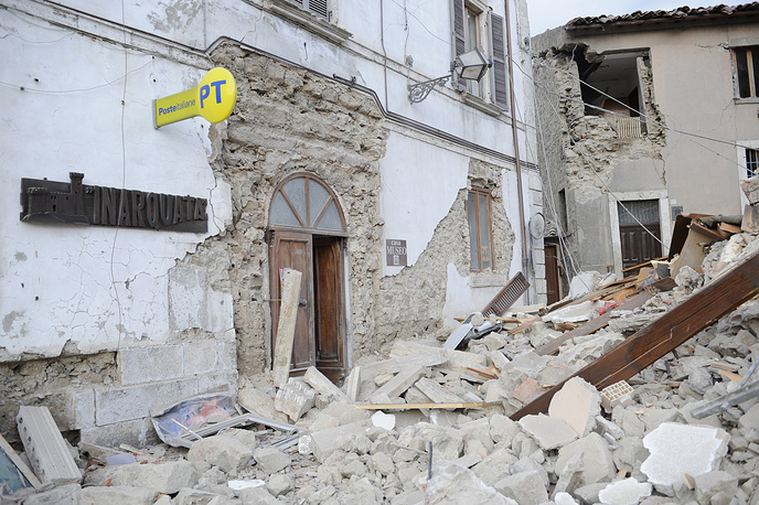 A post office is engulfed by rubbles in Arcuata del Tronto, central Italy