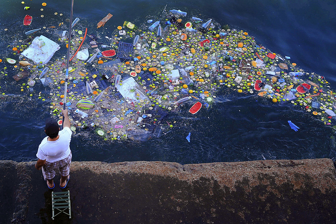 A floating trash hits the coastline of the Mediterranean Sea in Beirut, Lebanon, Sept. 29