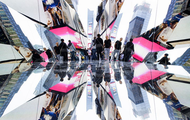 People are reflected in an art installation by Cuban artist Rachel Valdes Camejo titled 'The Beginning of the End' in Times Square in New York, USA, October 18