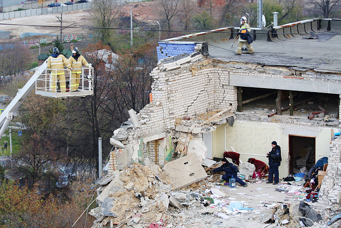 Russian Emergency Situations Ministry employees and fire service officers in an apartment building partially destroyed by a domestic gas explosion in Ryazan, Russia, October 24
