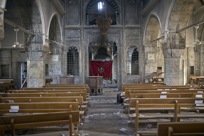 The inside of the church of Saint Shmoni, damaged by Islamic State fighters, in Bartella