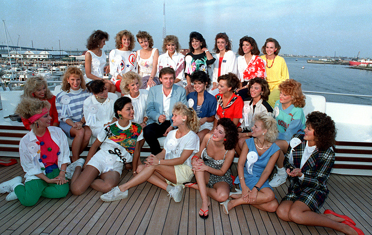 Donald Trump poses with about half of the competing State Misses on board his yacht in Atlantic City, 1988