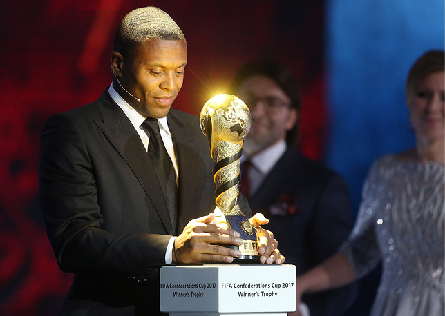 Brazilian footballer Julio Baptista holds a trophy at the FIFA Confederations Cup Russia 2017 draw, November 26