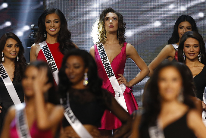 Candidate Zoey Ivory from the Netherlands reacts on stage during the 65th Miss Universe pageant coronation ceremony