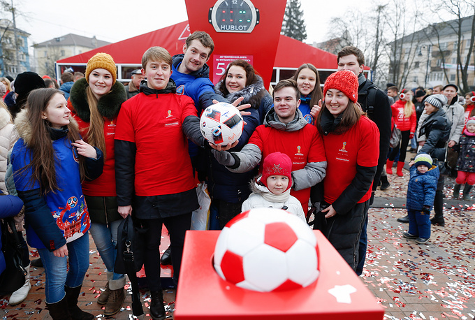 Volunteers at the launch of a 2018 FIFA World Cup countdown clock marking 500 days before the start of the World Cup in Kaliningrad