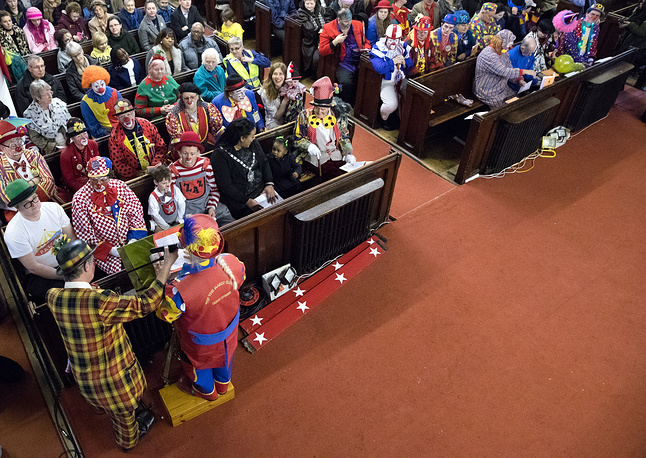 People dressed as clowns at the 71st annual memorial service gathered to celebrate the life of the famous English clown Joseph Grimaldi (1778-1837) at the All Saints Church in London, Britain, February 5