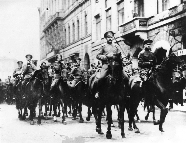 February Revolution in Russia centered on Petrograd (now known as St. Petersburg), then the Russian capital, arguably beginning on March 8 (February 23 in the Julian calendar). Photo: Soldiers riding down a street in Petrograd during the outbreak of the 1917 revolution