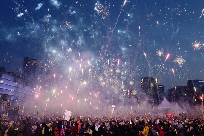 South Koreans release fireworks as they gather to celebrate after the court's ruling on the impeachment of South Korean President Park Geun-hye on the downtown in Seoul, South Korea, March 11