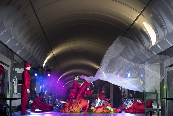 Actors perform during the Night in the Metro at Dostoyevskaya subway station in Moscow, Russia, March 12
