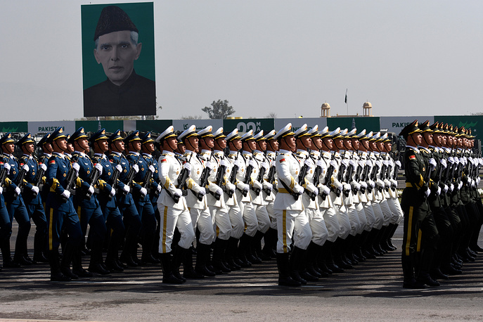 Chinese troops march past Muhammad Ali Jinnah, founder of Pakistan in the country's Republic Day parade in Islamabad, Pakistan, March 23